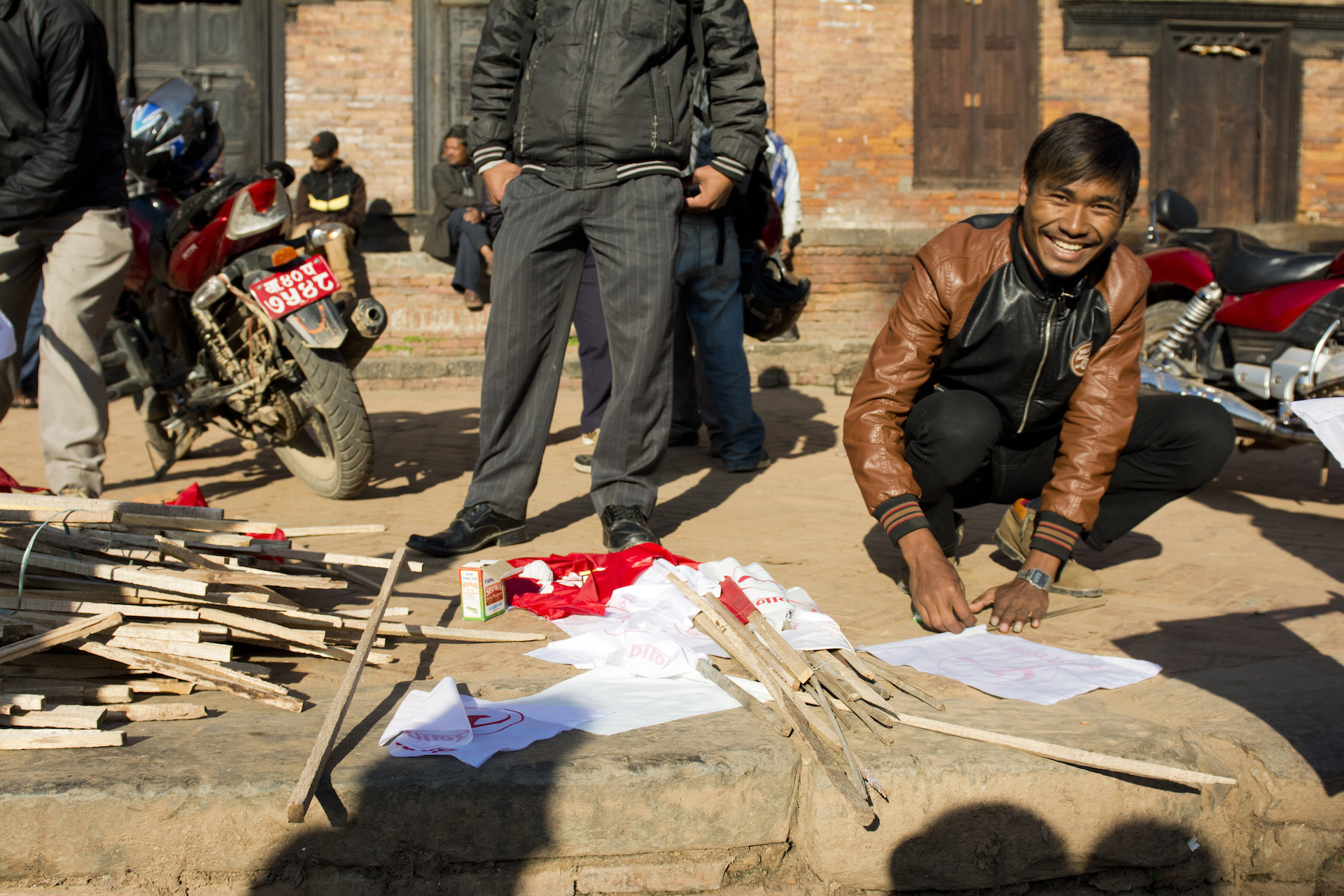 A Nepali man prepares flags for a political rally in Kathmandu. The flags were held up by motorcyclists as they wound through Kathmandu's narrow streets.