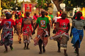 FRELIMO female supporters wear capulanas, a Mozambican traditional outfit, as they march in the streets of the Island de Mozambique, part of Nampula province.